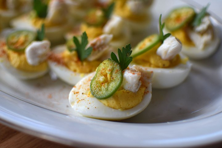 Crabby Deviled Eggs with pickled Jalapeno