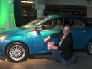 Green Living Guy next to Ford Focus Electric