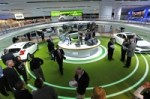 """The focal point of Ford's """"Living Electric"""" display at the North American International Auto Show is the 208 foot track which allows attendees to ride in one of Ford's new electric vehicles, the Ford Focus or Transit Connect Electric. Credit: Ford Motor Co."""
