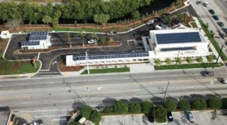 "Image Source #1: PNC Bank's ""green branch"" in Ft. Lauderdale, Fla., adds an increasingly popular twist to traditional building construction: Direct current powers LED lights right off the facility's 211 solar panels, eliminating the loss from AC-DC conversion. Photo courtesy of PNC Bank."