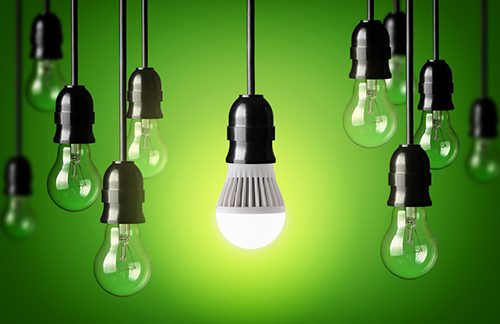 LED bulb and simple light bulbs.Green background
