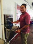 Bottle filling station. José Cerna NMSU closeup using reusable bottle at elkay water fountain