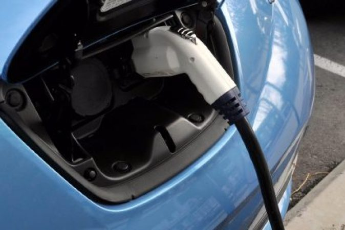 A charging plug recharges the Nissan Leaf electric vehicle. Photographer: Mark Elias/Bloomberg