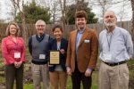 Representatives from the community of Islesboro, Maine, accept the Island Energy Innovation Award from Harry Podolsky of the Island Institute's energy team. (Pictured L-R: Melissa Olson, Patrick Phillips, and Sanni Cohn of Islesboro Central School; Podolsky; and Toby Martin of the Islesboro Energy Committee)