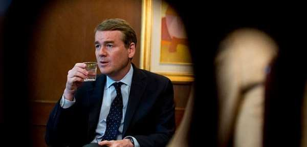 Democratic U.S. Sen. Michael Bennet of Colorado is seen through cutouts in a wooden chair July 4, 2017, during a meeting with a group of journalists in Mexico City. Bennet said James Carroll, acting director of the Office of National Drug Control Policy (ONDCP), would use scientific data to evaluate the effects of cannabis legalization in Colorado and other states. (Associated Press File Photo/Rebecca Blackwell)