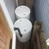Pierre had two barrels installed. The gutter feeds into one, fills that one up, and then the overflow goes into a second barrel. Once that second barrel is full, the overflow then goes into the storm train. Installation was by District Garden (info@districtgarden.com),.