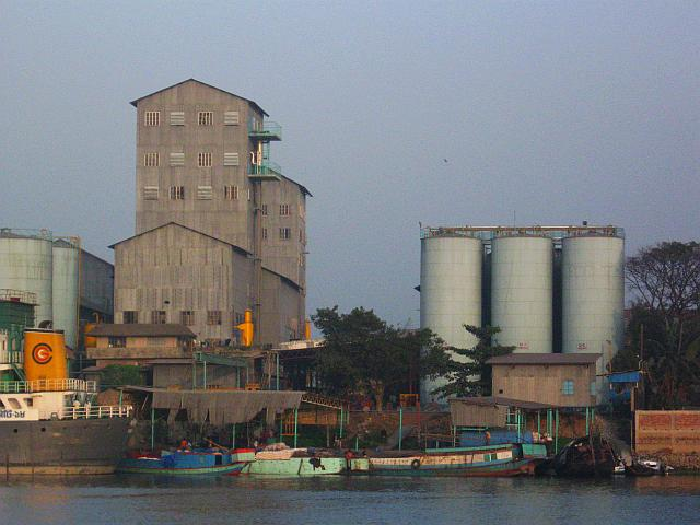 Cement factories line the banks of the Shitalakhya River