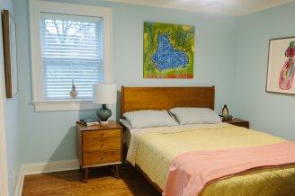 Master bedroom post-renovation. Photo courtesy Abby Smith at http://abbysmithphotography.pixieset.com/