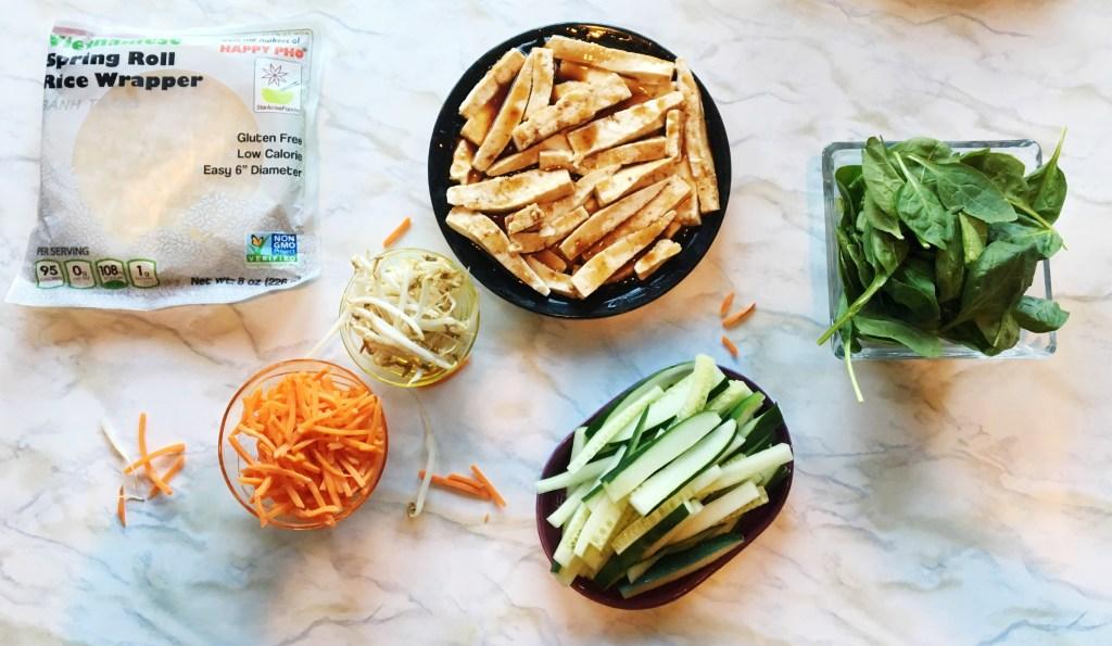 Asain Veggie Spring Rolls with Homemade Sweet & Spicy Peanut Sauce || these little bites are super healthy + the perfect crowd pleaser for any get together!