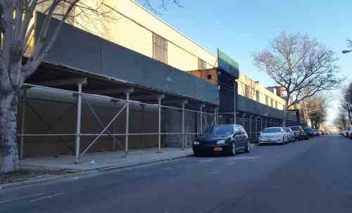 Scaffolding on Dupont Street in Greenpoint lacks visible permiting and stretches far beyond Lot 57; A. Simon