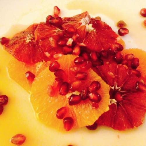 Close-up of plated orange & pomegranate salad