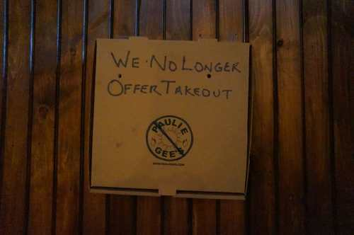 Pizza box signage at Paulie Gee's