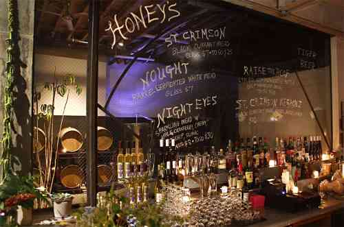 Behind the bar at Honey's. Photo via Honey's.