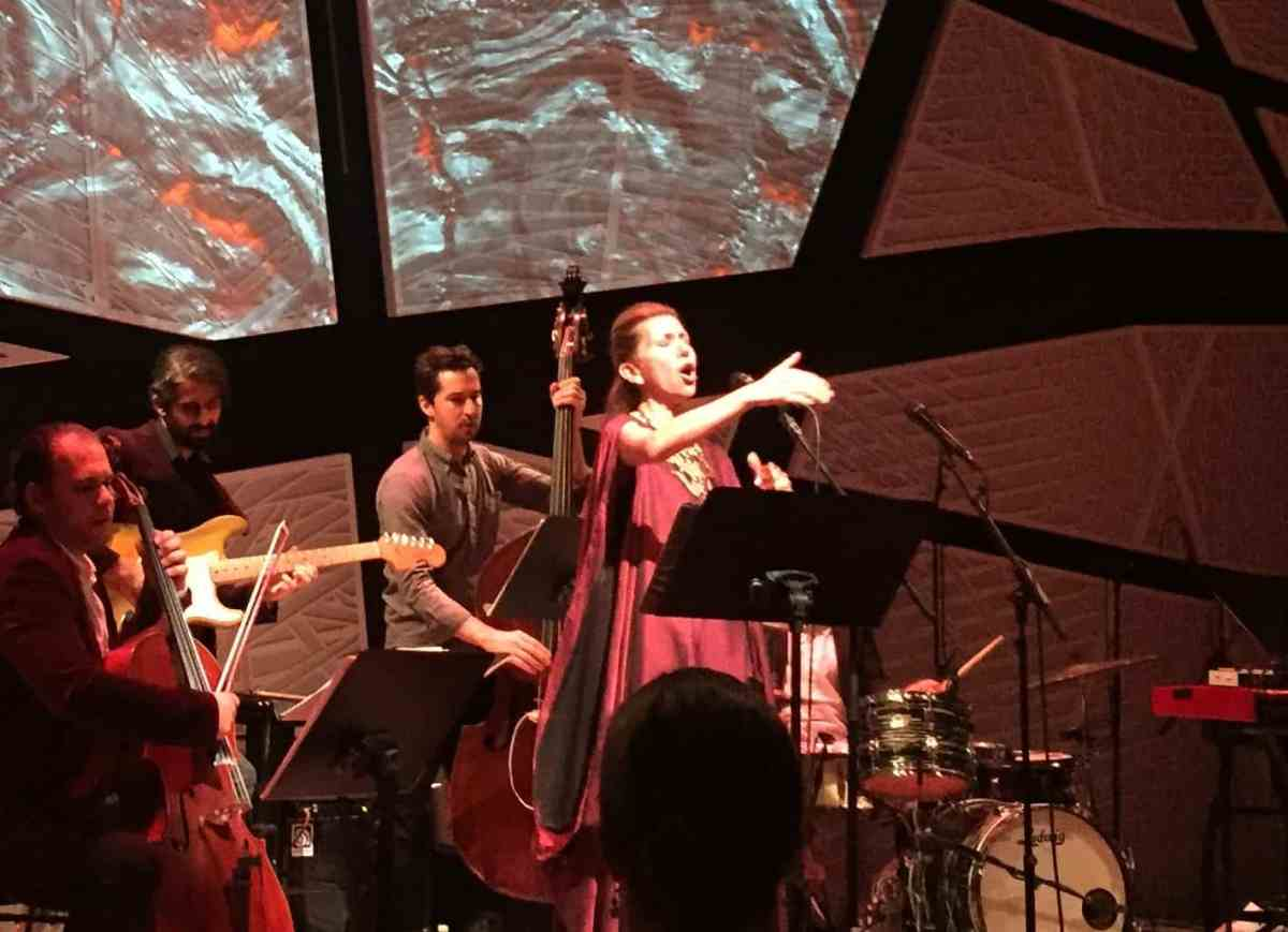 Singer Magos Hererra and the musical ensemble during the third course FIRE, during Elements of Time + Taste at National Sawdust. Photo: Megan Penmann