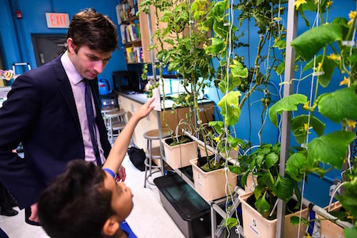 A student demonstrates the PS 34's new STEM Lab to Councilmember Stephen Levin. Via Bklyner