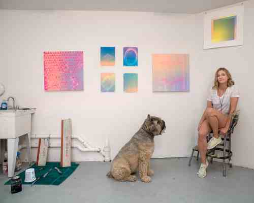 Kate McQuillen and her dog Kassie in her Greenpoint garage studio. Photo: Ian Hartsoe