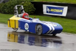 Car testing on a wet and windy track.