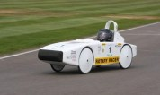 Chipping sodbury schools rotary racer driving on a track.