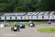 Coming up to the chicane at Goodwood Motor Circuit the Historic Super Shell building in background