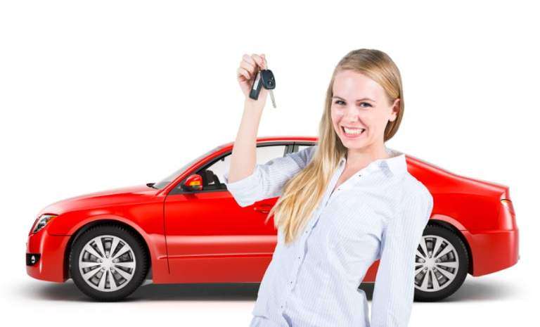Woman Holding Keys to Red Car Behind Her