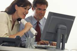 Businesspeople Viewing Computer
