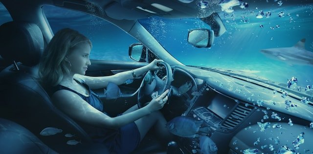 Woman Driving Car Underwater