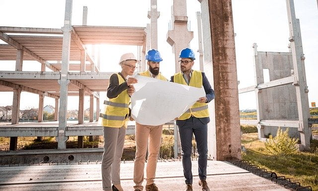 Architects Holding Plans