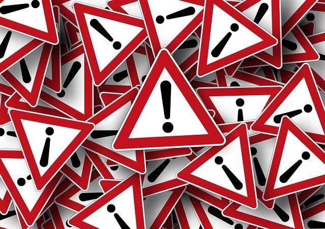 Caution Road Sign Pile