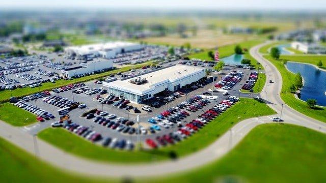 Aerial Tilt-Shift Photo of Car Dealership