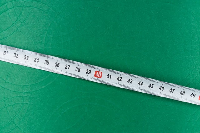 Measuring Tape on Green Textile
