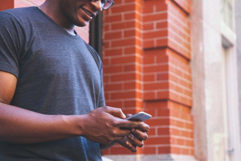 Man Using iPhone
