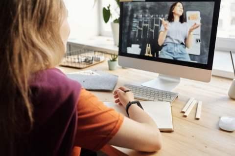 Woman Watching Woman on Computer Screen
