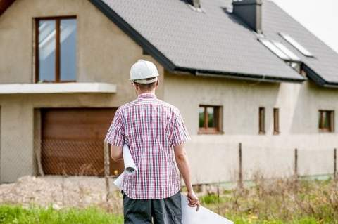 Architect Walking to House
