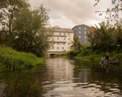 Looking back on the White Mill as we paddle in Canterbury on the River Stour, Kent, UK