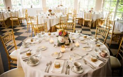 For the dinner and reception in the sun-drenched Pavilion, tables were set with cream linens, gold Chiavari chairs, tea party inspired centerpieces, and china. Favors?