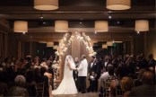 Porsha and Eric say their vows under a floral and fairy-light bower