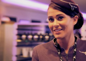 Inflite stewardess greets customer