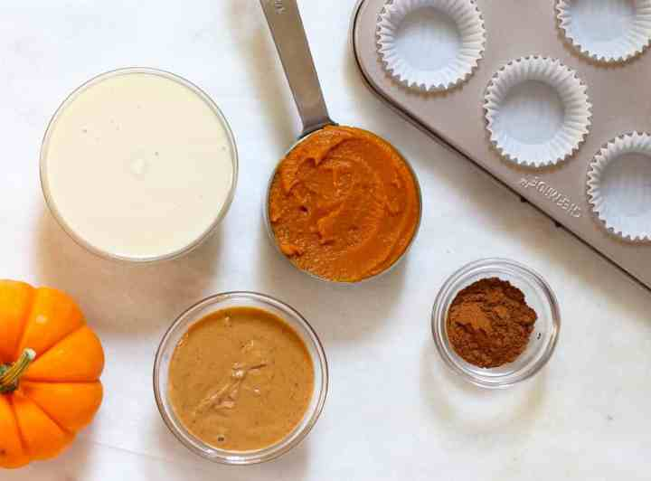 Ingredients laid out for pumpkin fudge on a white marble board.