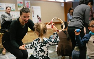 child dancing with adult