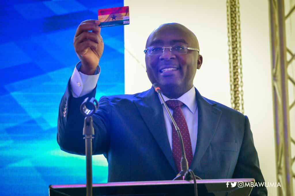 Mahamadou Bawumia holds a GH Dual Card