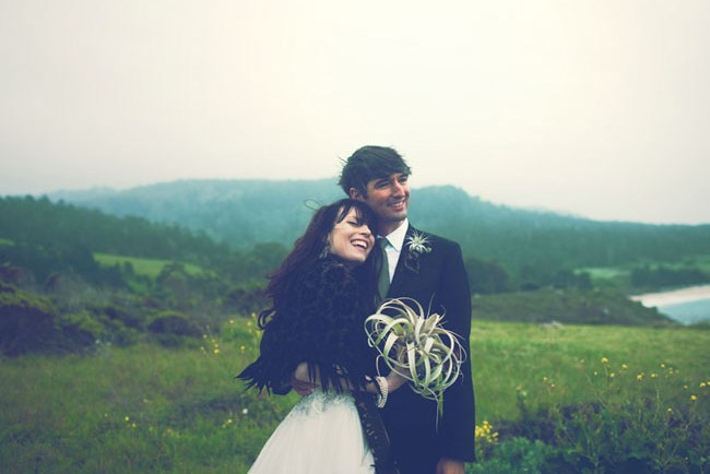 wedding couple with airplant bouquet