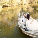 bride and groom in a boat