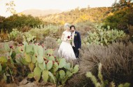 bride and groom in cactus field