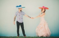 bride and groom wearing sombreros