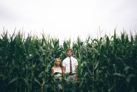 bride and groom in a corn field