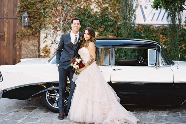 bride and groom with vintage car