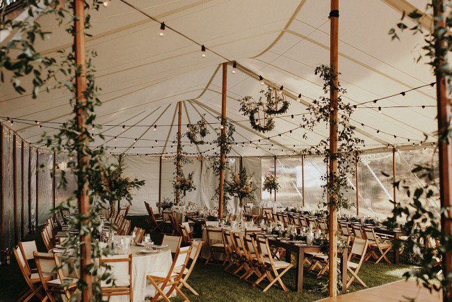 tent with tons of gorgeous greenery