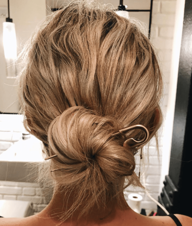 trending now: boho-chic messy bun wedding hairstyles - green