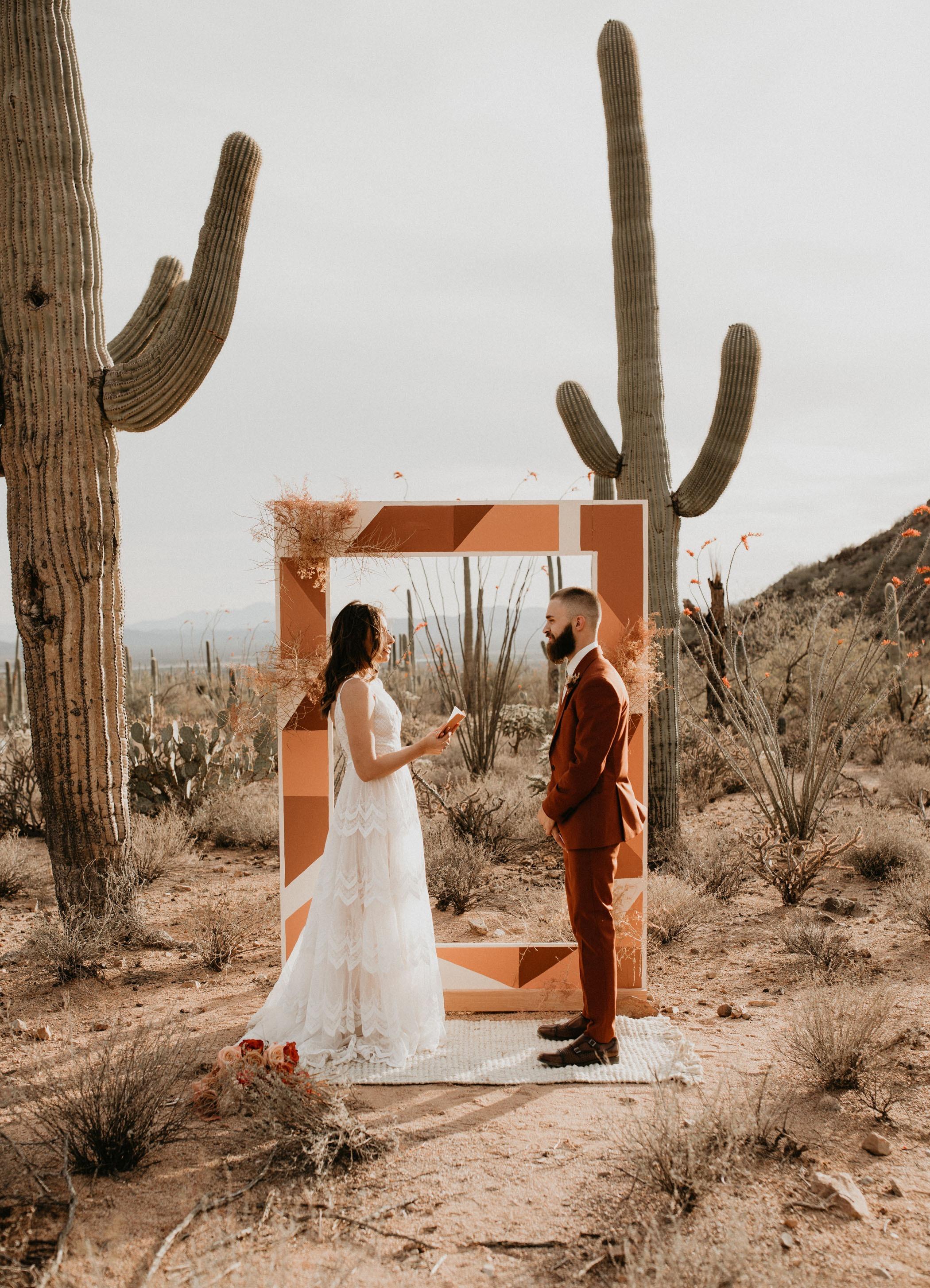 geometric painted wood rectangle DIY wedding backdrop for a desert elopement