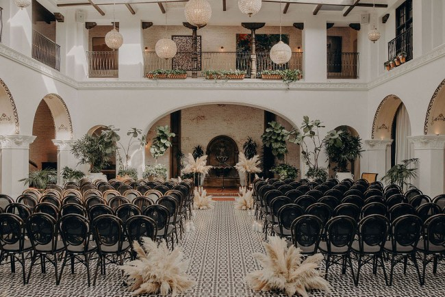 Masculine wedding decor- black and white ceremony with pampas grass and plants